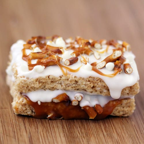 white chocolate stuffed krispy treat with caramel and pretzels