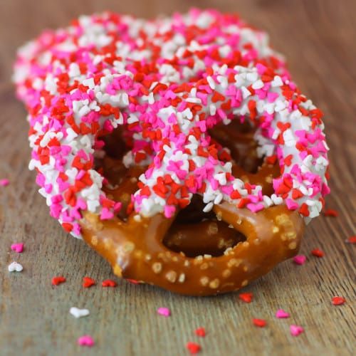 pretzels with dipped frosting and valentines sprinkles