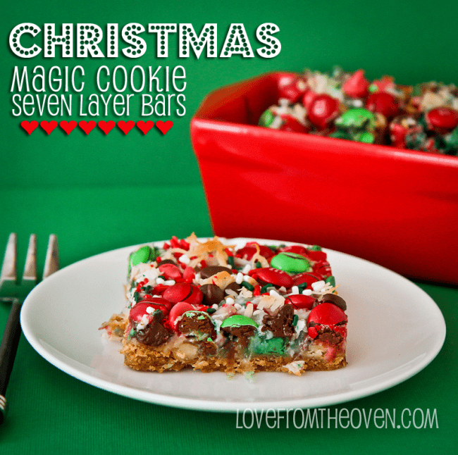 a slice of Christmas magic cookie bar on a white plate with a fork