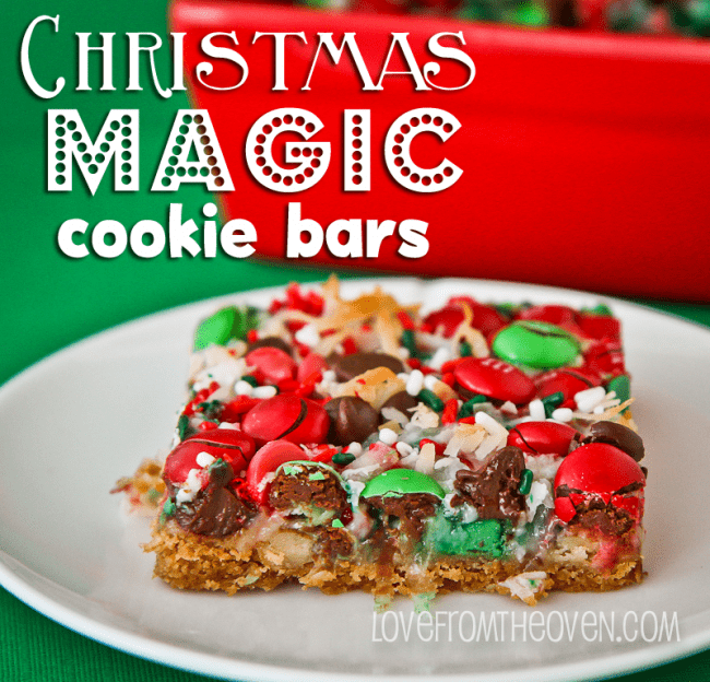 Christmas Magic Cookie Bars slice close up on a white plate with red baking dish in the background