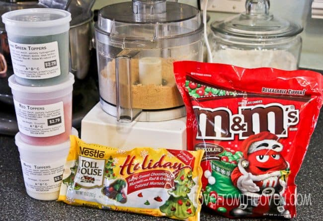 ingredients- red, white, and green sprinkles, holiday baking chocolate chips, coconut, graham cracker crumbs, holiday candies
