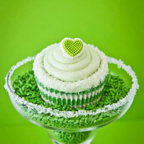 A lime cupcake in a margarita glass.