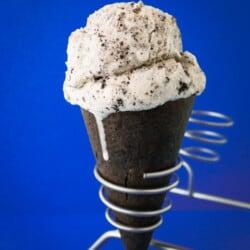 A photo of a cookies and cream ice cream cone made in a cuisinart ice cream recipe.