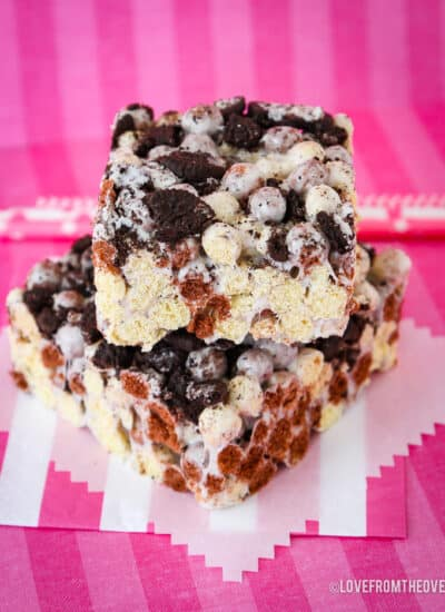 Cookies and Cream bars on a pink background.