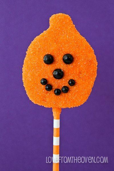 Orange sanding sugar and black SweetWorks Sixlets and Pearls.