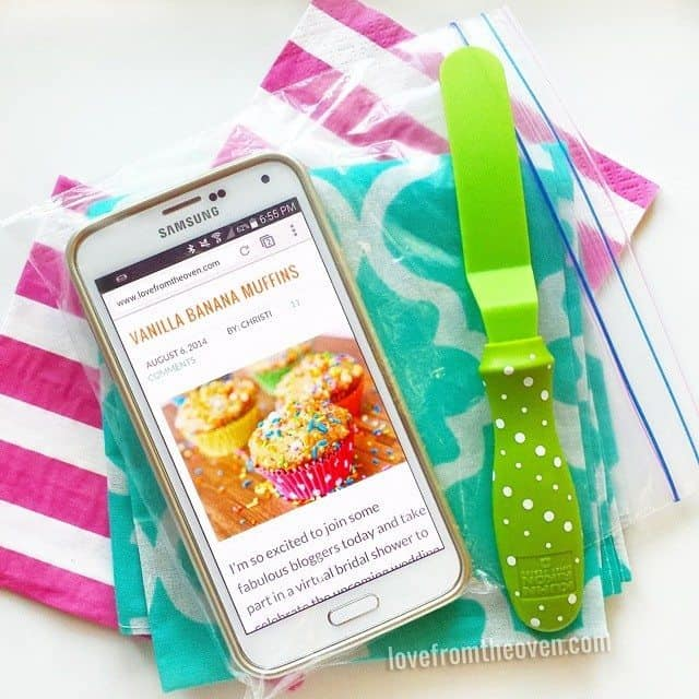 Putting your phone in a plastic bag to help protect it from drips in the kitchen. Great and cheap idea!