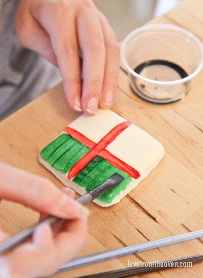 Paint cookies with a mixture of McCormick food coloring and extracts. This is so cool!