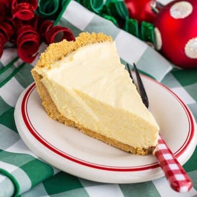 A slice of eggnog pie on a colorful background.