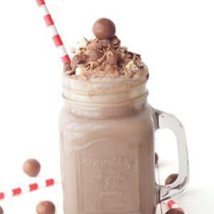 chocolate malt milkshake with a straw