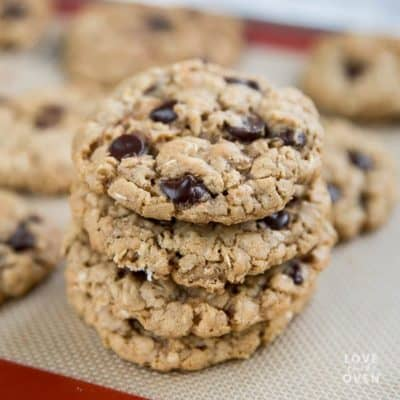 Stack of chewy oatmeal cookies on a baking tray