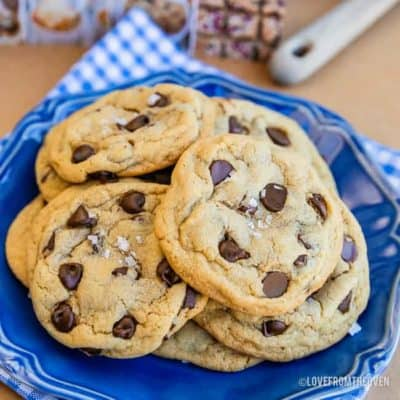 A pile of chocolate chip pudding cookies on a blue plate