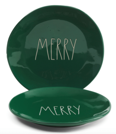 Green Rae Dunn Christmas plates that say merry in white letters