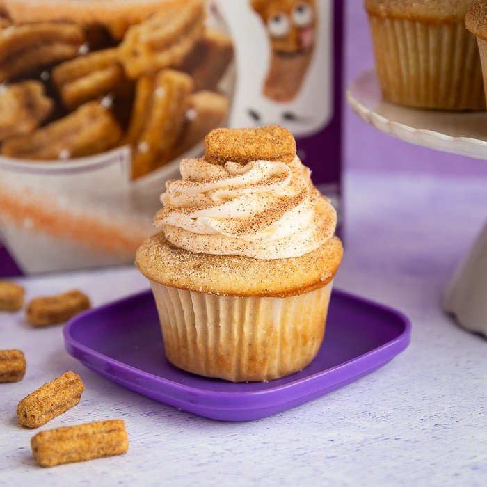 Cupcake with cinnamon and sugar topped with churro cereal
