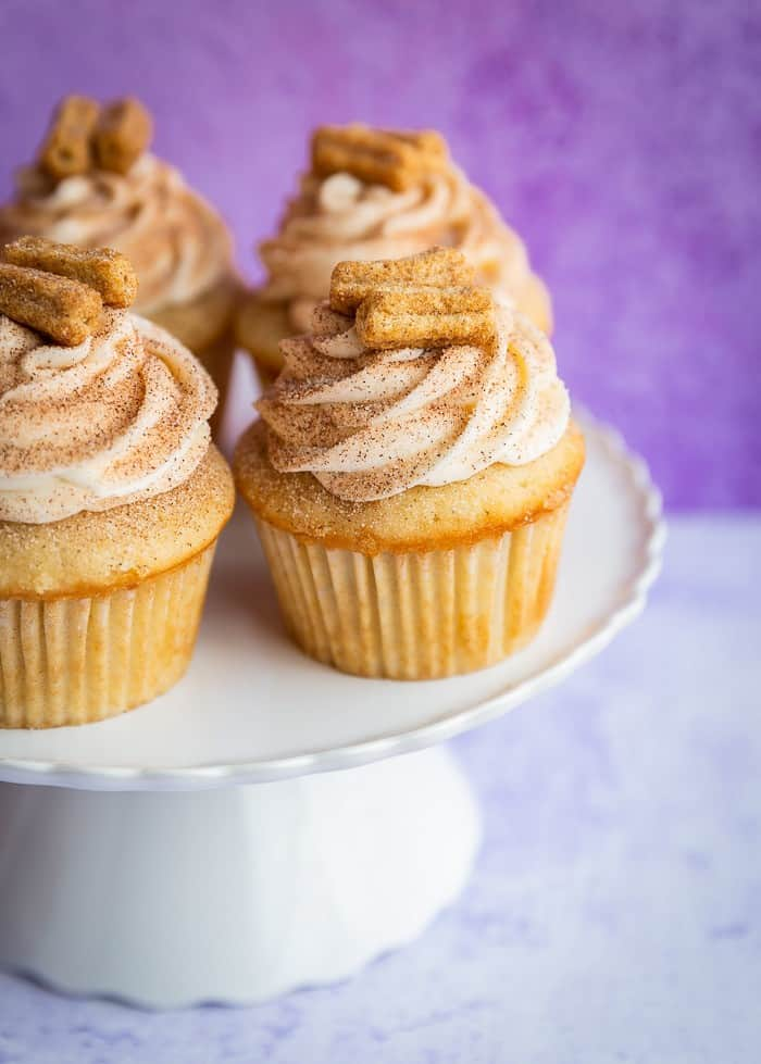 Churro cupcakes on a cake stand
