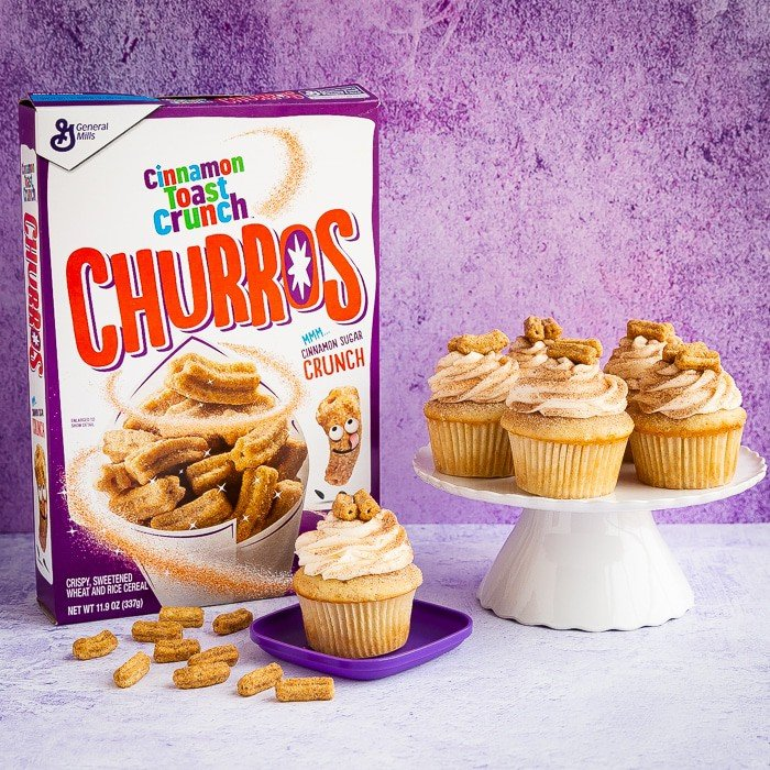 A box of Cinnamon Toast Crunch Churros Cereal with churro cupcakes