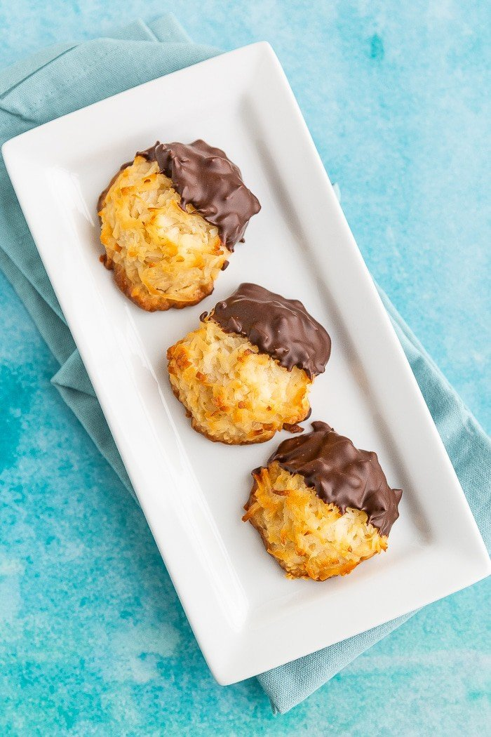 Chocolate dipped macaroons on a plate