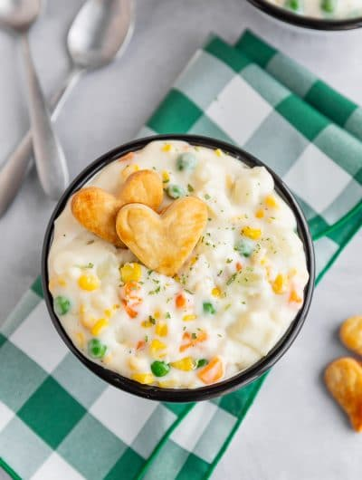 Bowl of pot pie soup on a green and white napkin