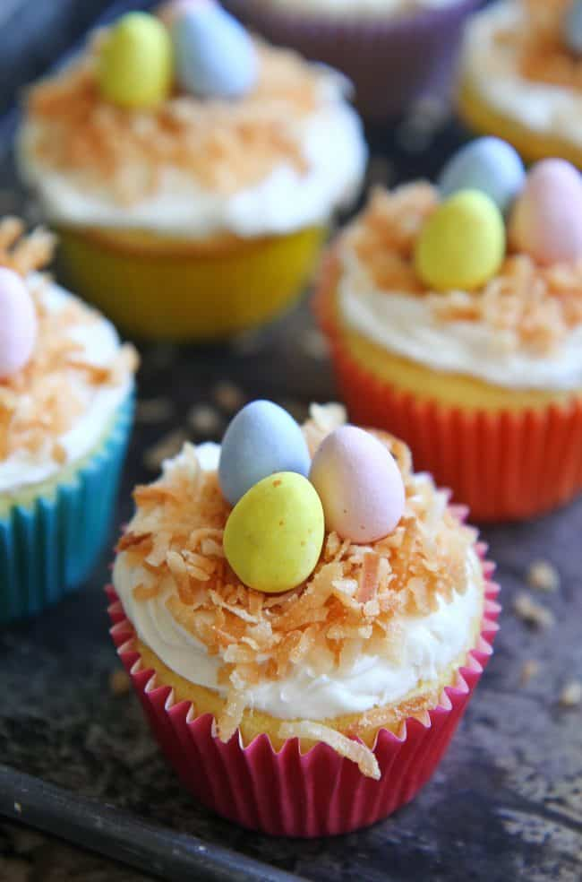 Coconut cupcakes with candy eggs and coconut on top