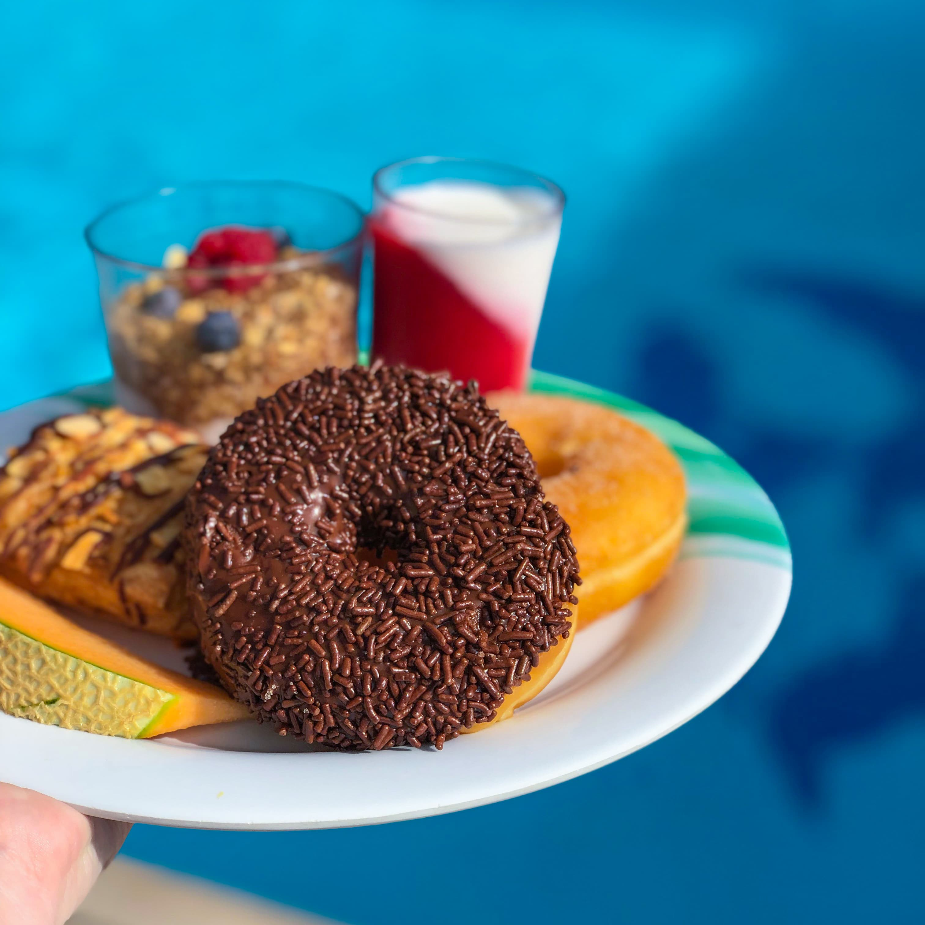 Plate with assorted breakfast items over a pool