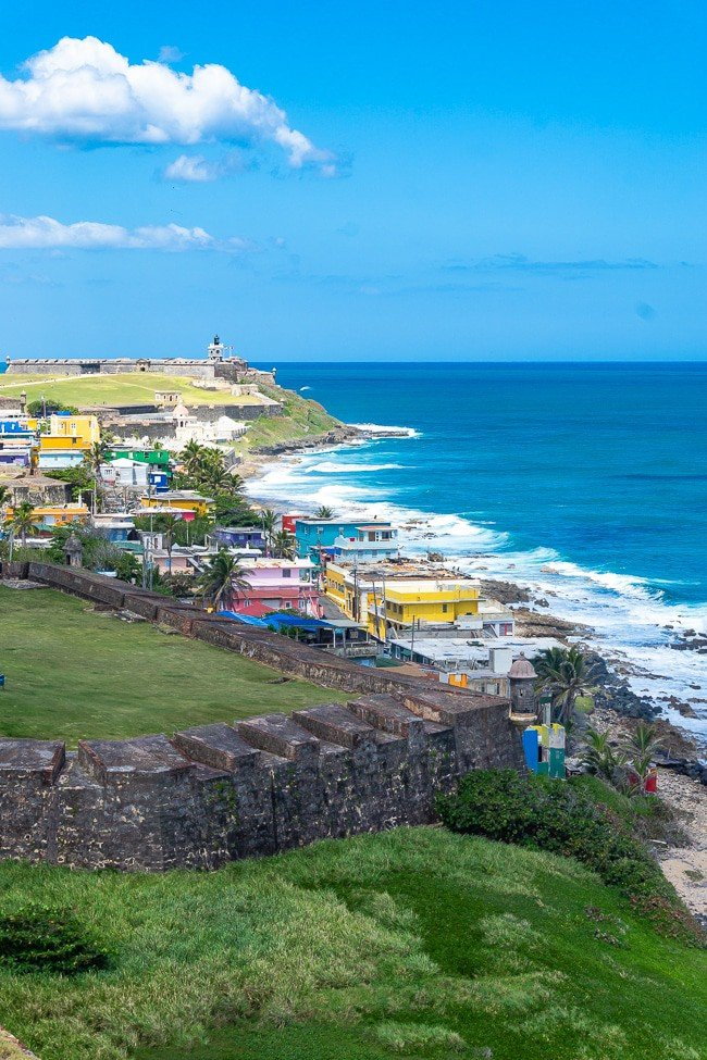View of mountain side, colorful houses and ocean in Puerto Rico
