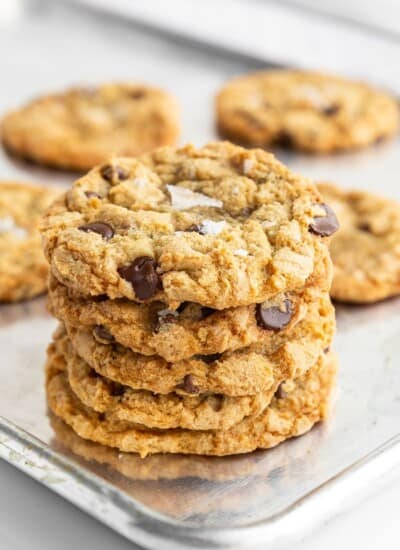 stack of crispy chocolate chip cookies on a cookie sheet
