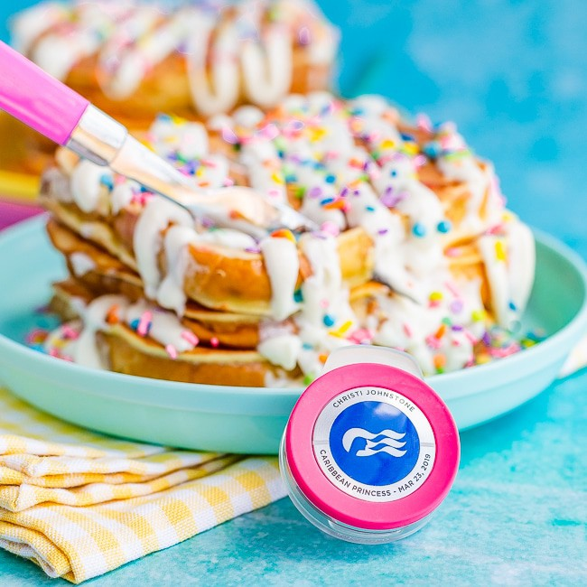 Easy French Toast with frosting and sprinkles, on a blue background, with a Princess Cruises Ocean Medallion in front of the plate
