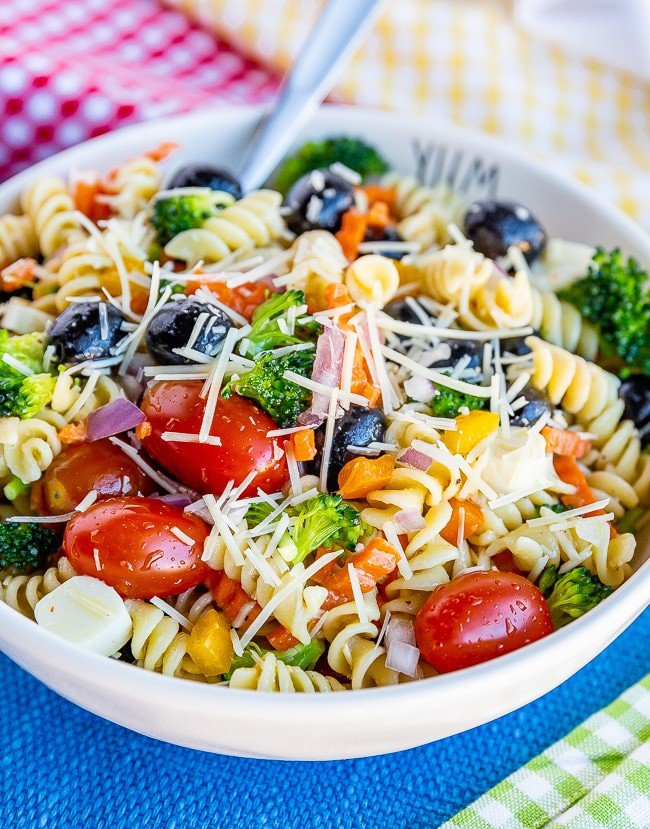 Bowl of pasta salad on a blue placemat