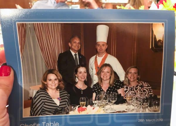 A photo of a chef and guests at a Chef's Table dinner on a Princes Cruise
