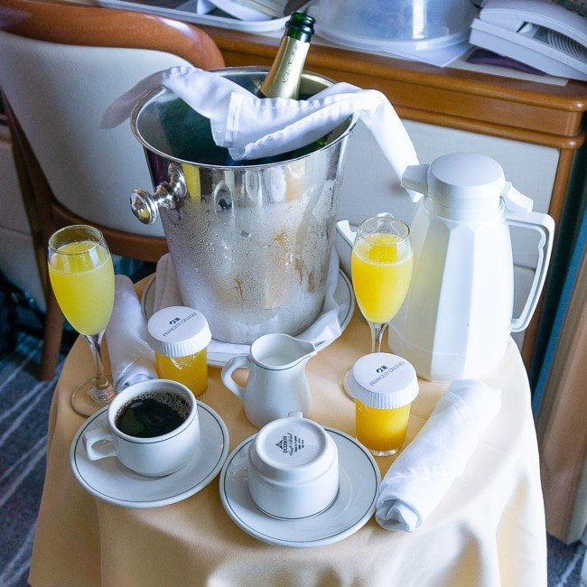 Orange juice, champagne and coffee on a table for a balcony breakfast on a Princess Cruise