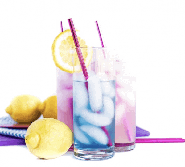 Blue cocktail in front of purple cocktails with lemons