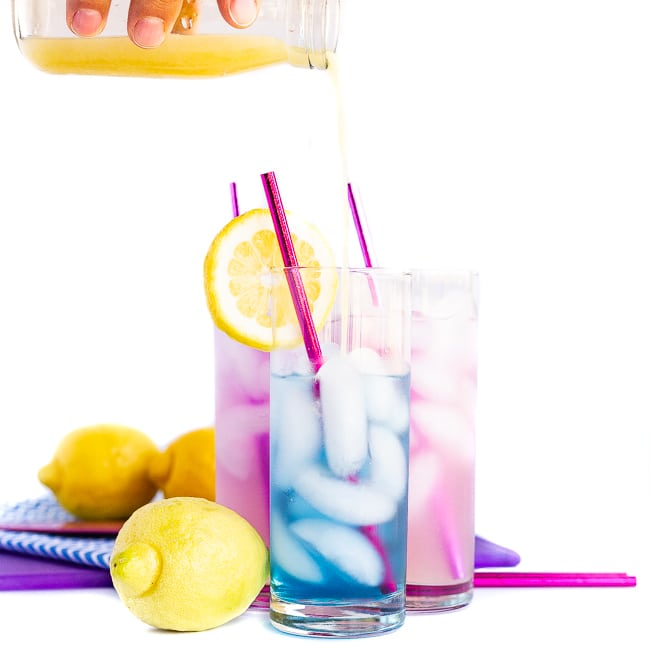 Blue and purple cocktails with lemons