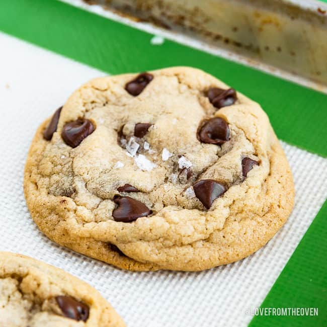 chocolate chip pudding cookie sitting on a cookie sheet