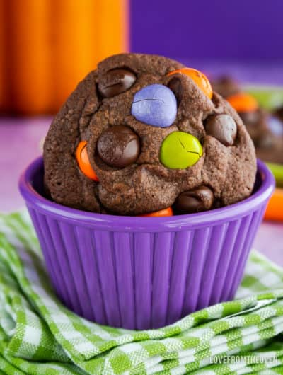 Chocolate Cookie with M&M candies in it, sitting in a purple bowl on top of a green and white napkin