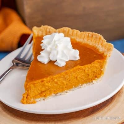 A close up of a slice of pumpkin pie