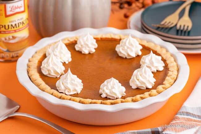 a libbys pumpkin pie on an orange background