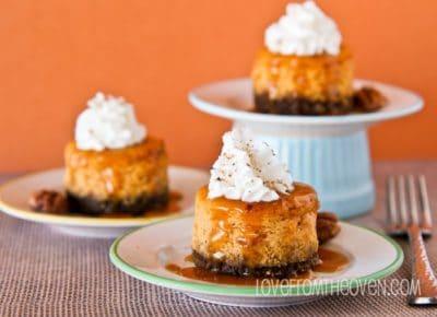 Three mini pumpkin cheesecakes on plates