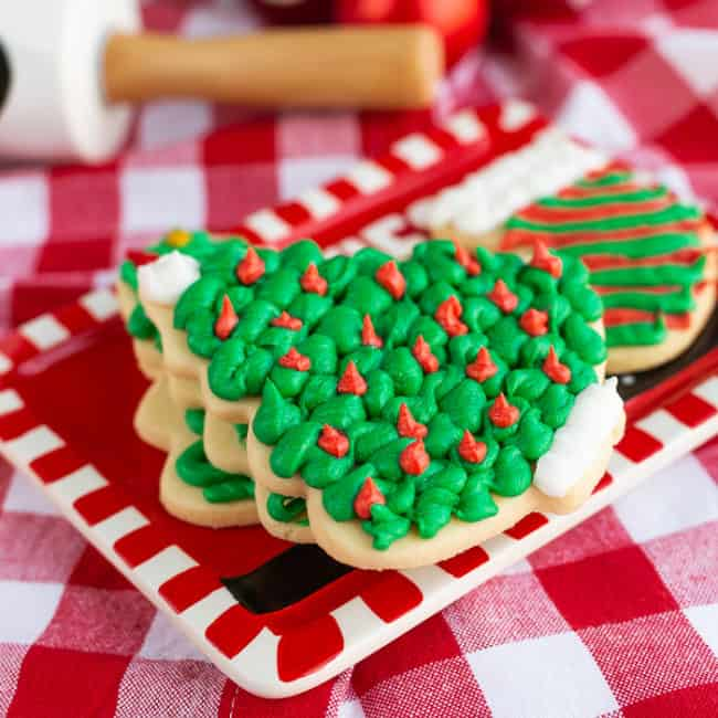 Frosted sugar cookies on a red and white plate