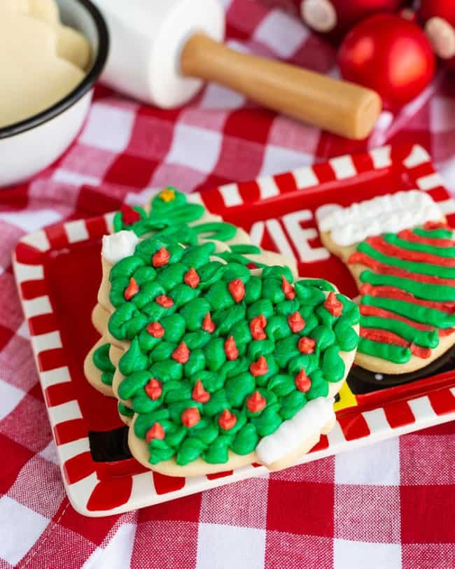 Frosted sugar cookies on a red plate