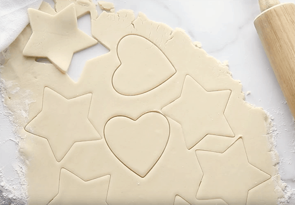 Sugar cookie dough with various shapes cut out