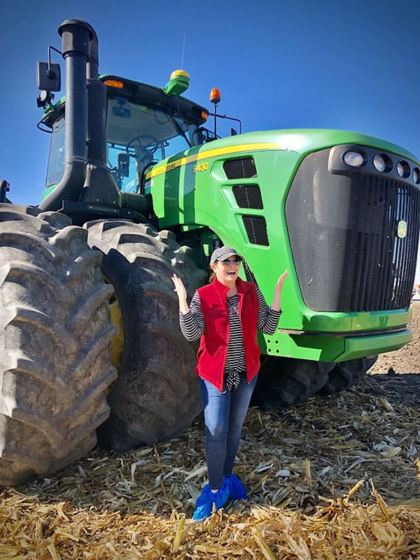 A person in front of a tractor