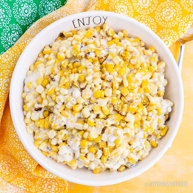 A photo of a large bowl of creamed corn