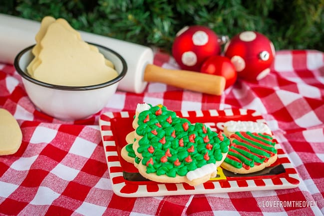 Several sugar cookies on a red plate