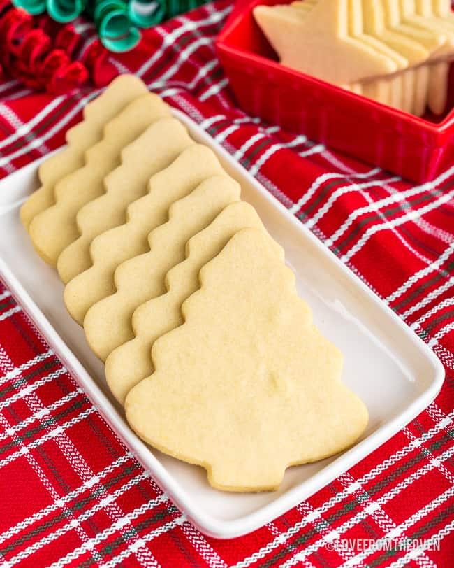 Christmas tree shaped sugar cookies on a white tray