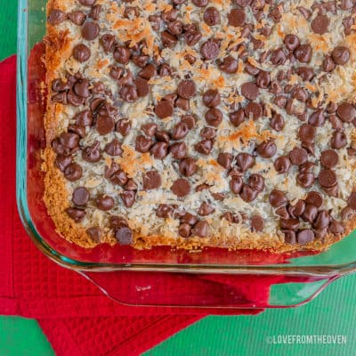 Magic cookie bars in a glass baking pan