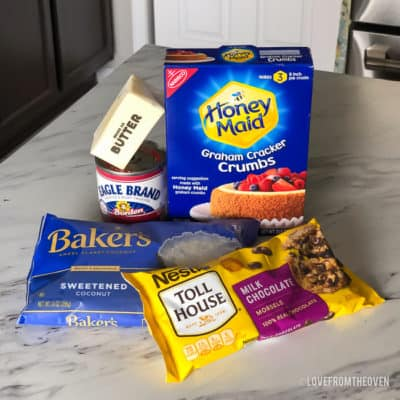 Ingredients for magic cookie bars on a white countertop