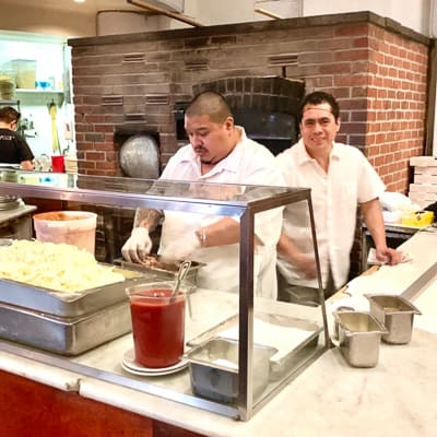 Two pizza chefs from John\'s NYC