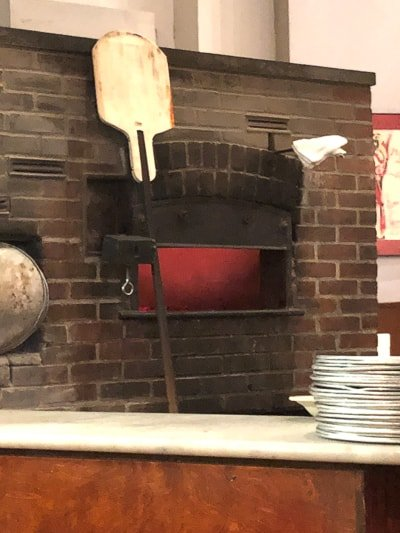 A photo of a pizza oven at John\'s NYC