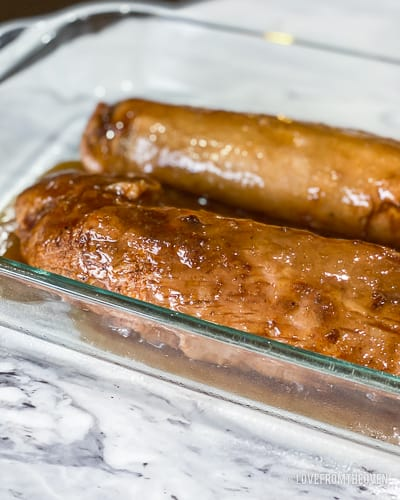 Two pieces of pork tenderloin in glass baking pan
