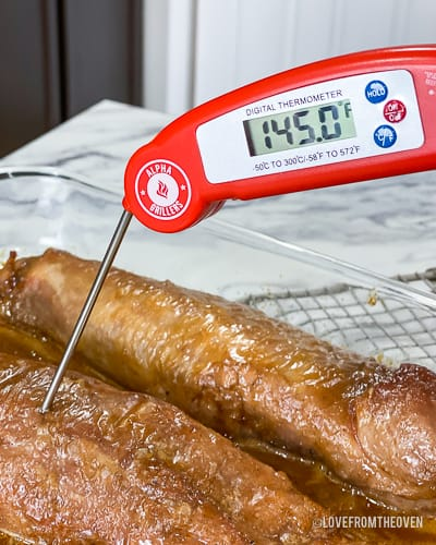 Meat thermometer reading 145 degrees Fahrenheit