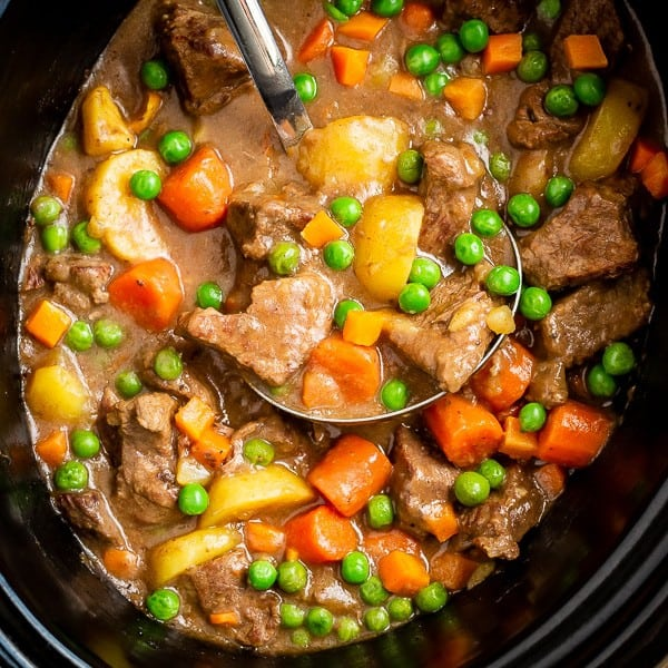 Shot of beef stew in a crockpot with a ladle